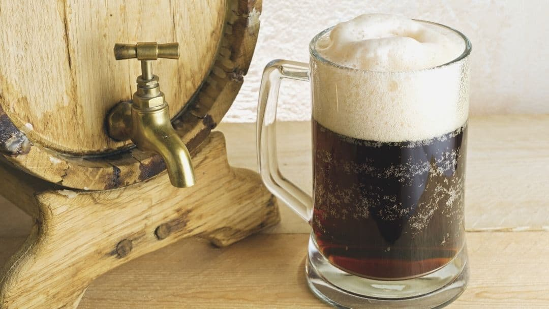 cola and beer in a glass